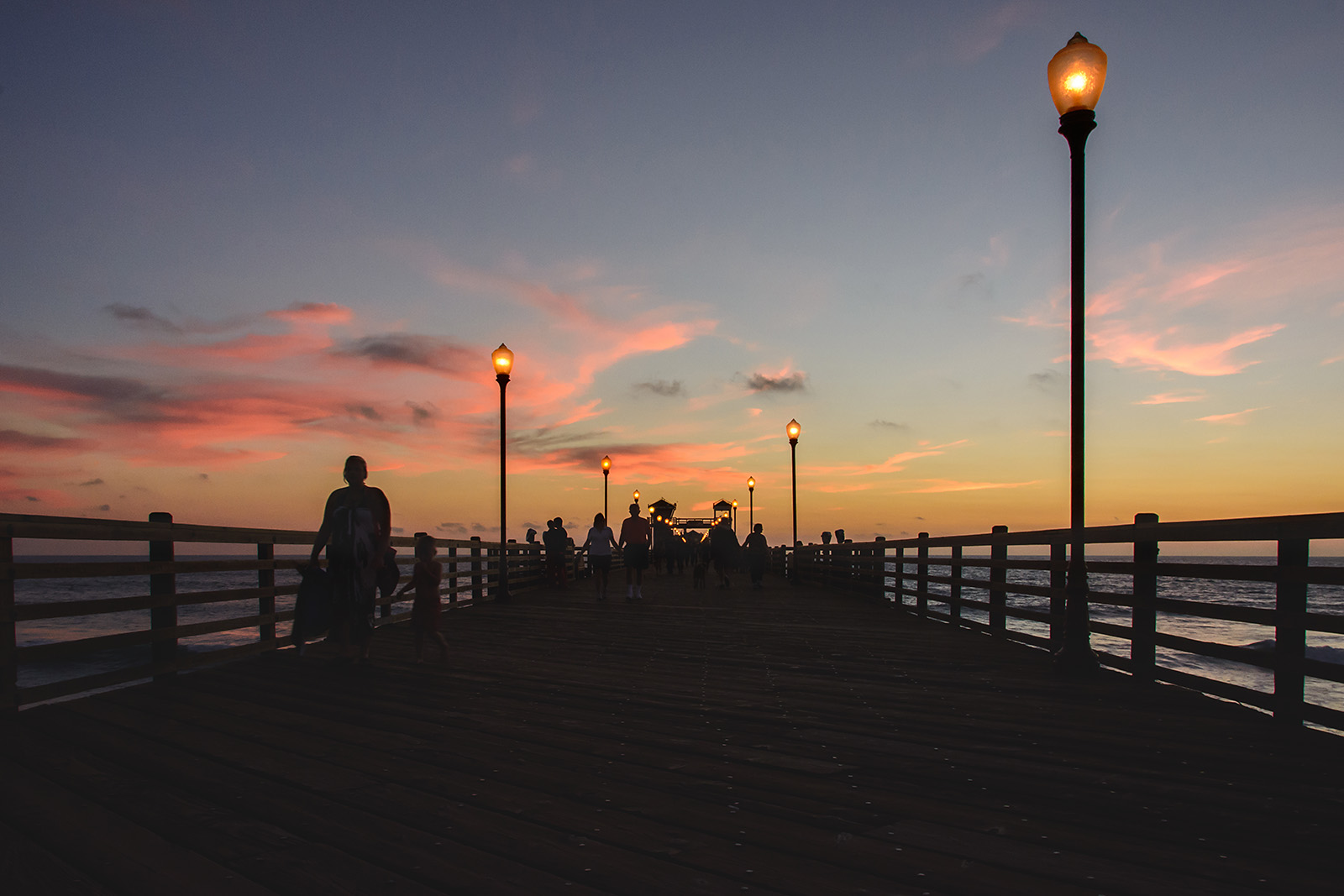 Walking the pier at sunset in Oceanside, California (photo by Tyann Marcink)